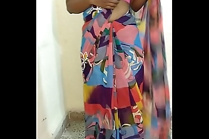 Indian desi wife dethroning sari with an increment of fingering pussy till orgasm with moaning