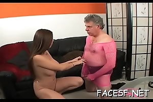 Cutie gives a with an eye to footjob